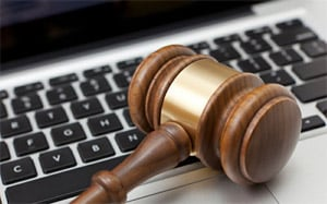 Gavel on a keyboard - legal considerations for business content