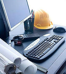 Engineering tools - blueprints, computer, hard hat