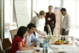 People presenting around a conference table