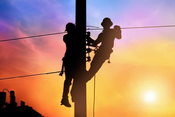 Photo of powerline workers at work