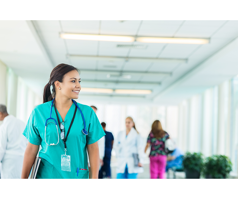 Photo of a healthcare professional walking down a hallway